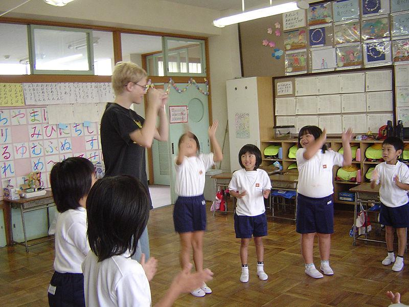 "Japanese school children near play ""Heads, Shoulders, Knees and Toes."""