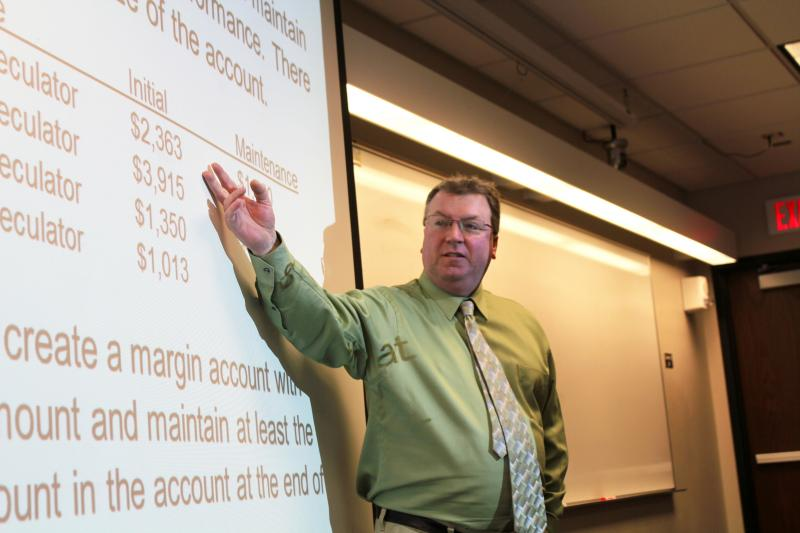 Iowa State University economist Chad Hart teaches a course on grain marketing. The students play an on-line game called Commodity Challenge.