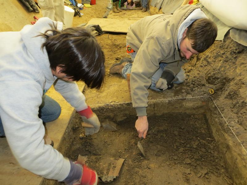 Project archeologists sift through dirt in a heated tent set up in Hubbard Park.