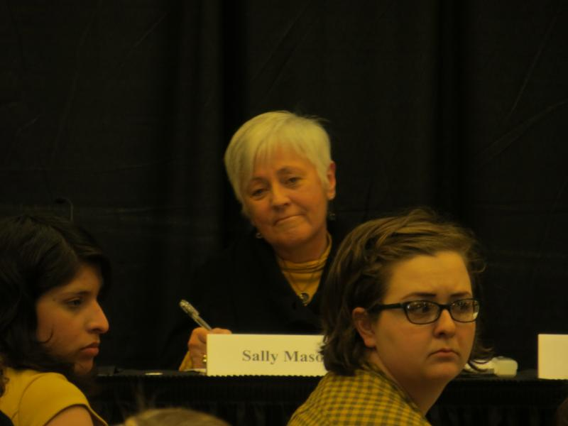 Mason listens to student testimony during an on-campus forum.