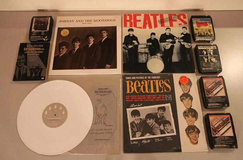 """Bootleg"" LPs (one with the recordings that earned the Beatles a rejection slip from Decca Records), some 8-track tapes, and one of Bob Dorr's most collectable, a limited edition (2500) 12"" white vinyl record of Happy Xmas by John Lennon"