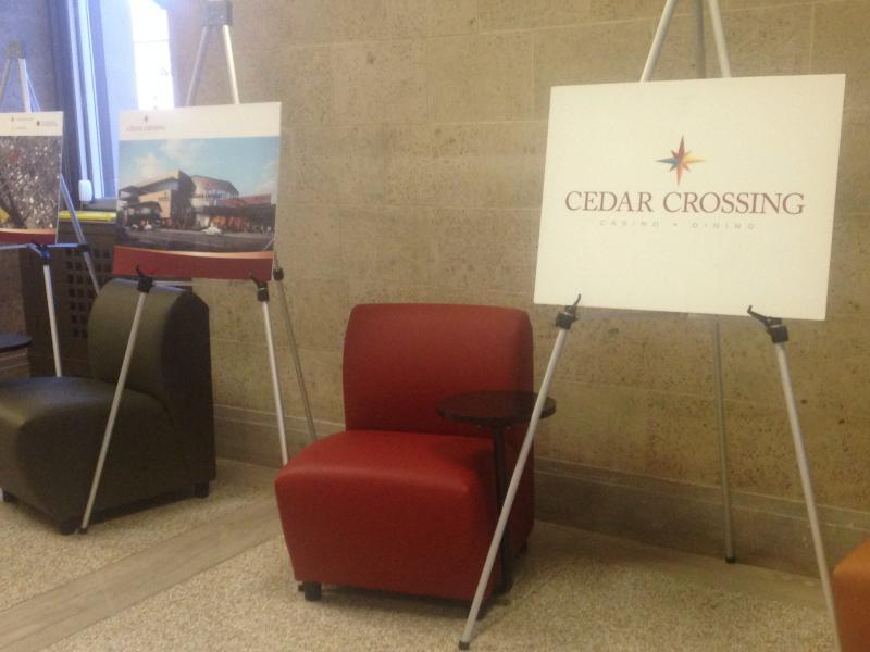 Signs for a Cedar Rapids casino line the first floor of City Hall.