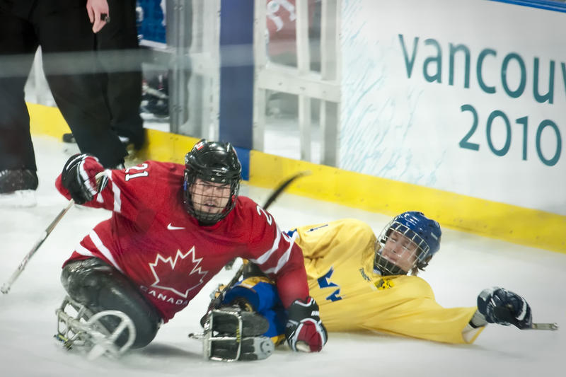 Sled hockey includes hard hits like this one in the 2010 Olympics in Vancouver