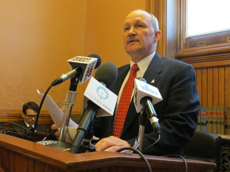 Bill Dotzler, D-Waterloo, speaks to reporters at a press conference at the Statehouse.