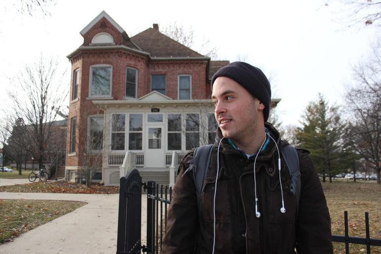 Art major Jordon Deutmeyer stands outside of the University of Northern Iowa Honors Cottage in December 2013