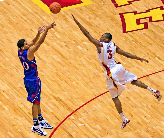 Iowa State Cyclone Melvin Ejim defending Kansas  Jayhawk forward Kevin Young in Ames, Jaunary 28, 2012.  Ejim was chosen as Big 12 Player of the Year earlier this month.