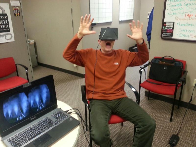 Host Ben Kieffer rides a roller coaster on the Oculus Rift, March 28, 2014.