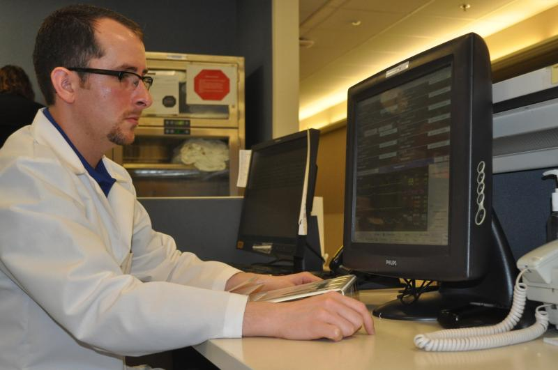 Dr. Joshua Pruitt checks a telemetry monitor in the Emergency Department at St. Luke's Hospital in Cedar Rapids.