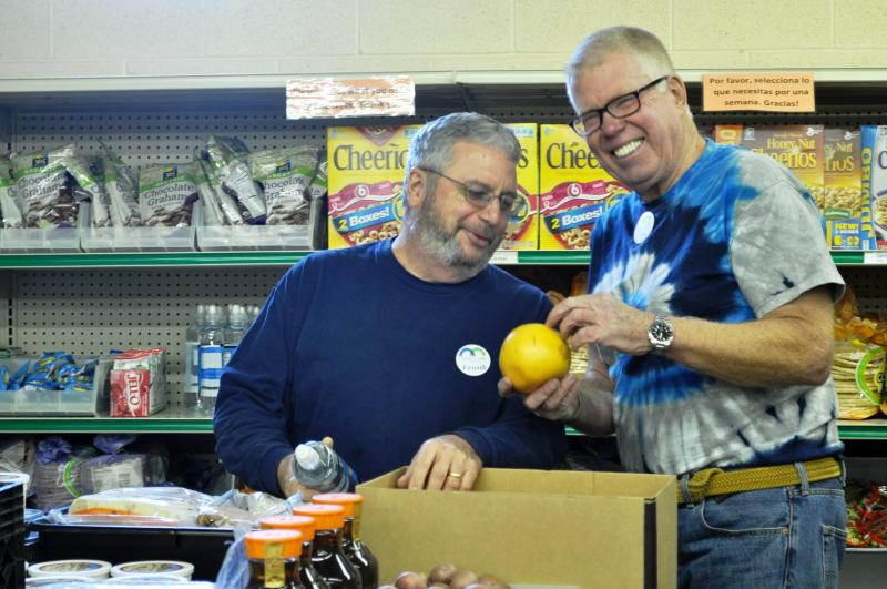 Volunteers unpack donated food at the Johnson County Crisis Center in Iowa City.