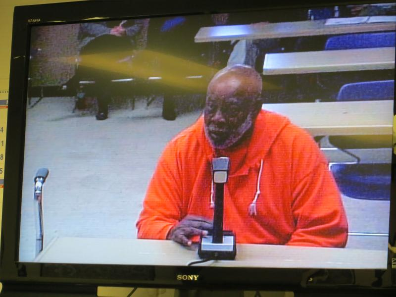 Rasberry Williams answers questions via closed circuit television from the Iowa Board of Parole.