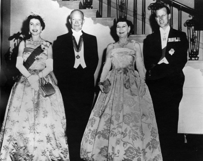 From left to right, Queen Elizabeth II, President Dwight D. Eisenhower, First Lady Mamie Eisenhower and Price Phillip. Note how the queen and first lady are wearing a similiar style of ball gown.