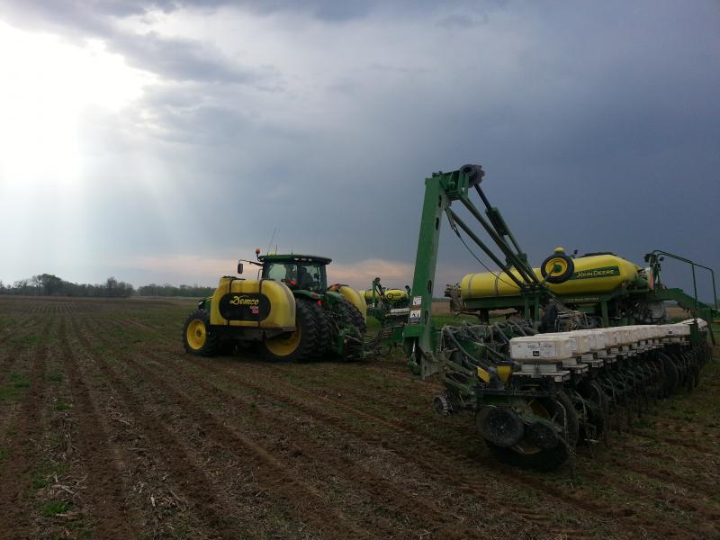 A storm cell rolls in while Johnson County farmer Jim Sladek is planting corn