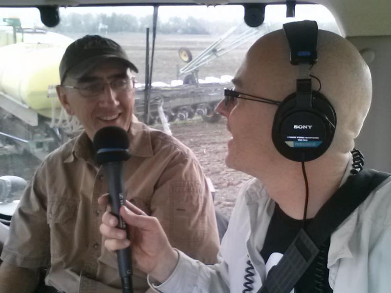 Host Ben Kieffer and Jim Sladek up in the tractor cab