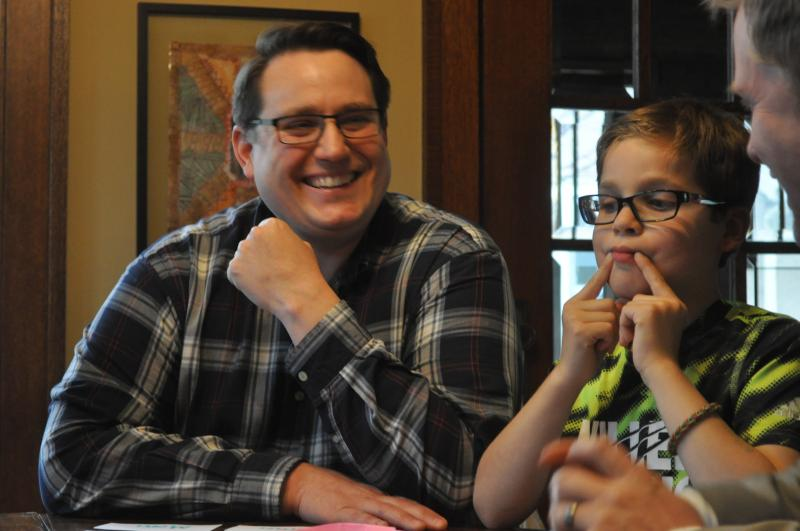 Jim Lynch and his son Nolan, 9, participate in a home-based therapy session in Des Moines.