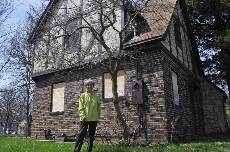Sandy Paulsen stands in front of her former home, in Mason City's historic East Park neighborhood.