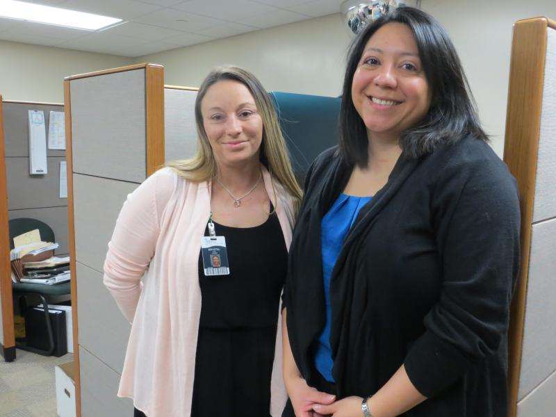 Karla Vaquerano-Serio (right) and Krystal Nichols are patient advocates at Mercy Medical Center in Des Moines.