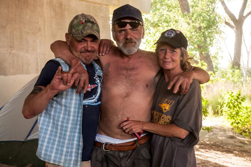 Rod Mundy, Rick Mundy, and Bonnie Schroeder at their camp near downtown Des Moines.