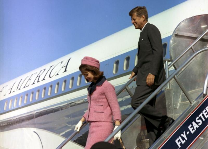 President John F. Kennedy and First Lady Jacqueline Kennedy descend the stairs from Air Force One at Love Field, Dallas, Texas