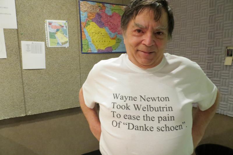 Paul Ingram wearing a clerihew in Iowa Public Radio's Iowa City studio