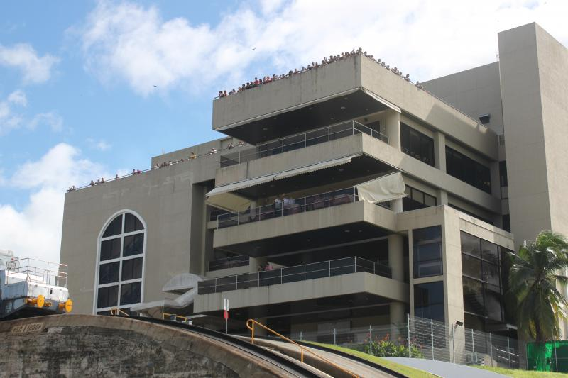 Sightseers gather on the observation tower at the Miraflores Locks.