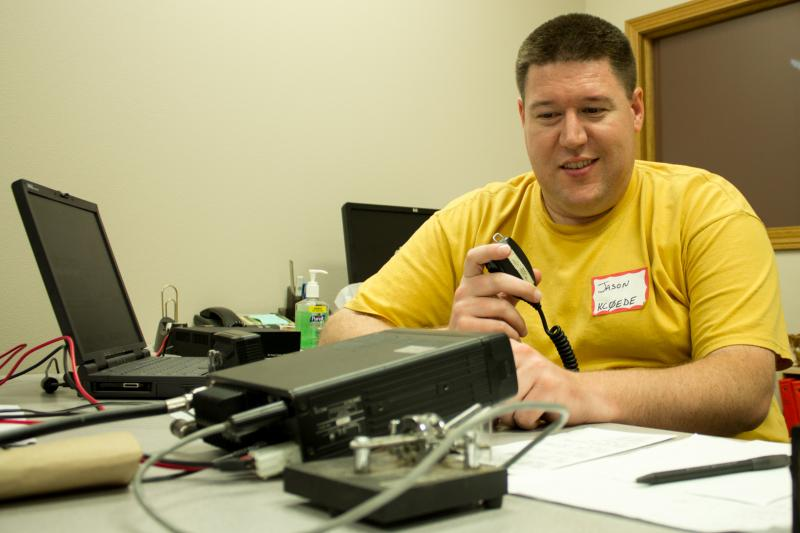 "Jason Skretta, KC0EJT, scans frequencies in the ""shortwave"" band to find voices of other amateur radio operators in North America during the annual summer contest ""Field Day""."