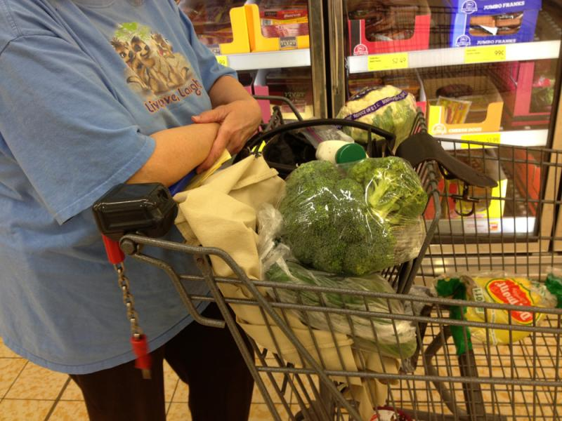 Ramona, a 71-year-old retired teacher who gets $25 a month in food stamps, stocks up on fresh vegetables and fruit at an Aldi Supermarket in Kansas City.