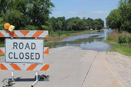 Flooding closed a portion of a road in southeast Johnson County, July 1 2014