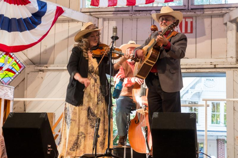 Castle Ridge plays on the Pioneer Hall stage.  The bluegrass trio from Tiffin have been together since 2006. Guitarist Mark Clark sings with his wife violinist Joy Ward, and bassist Roger Anderson.