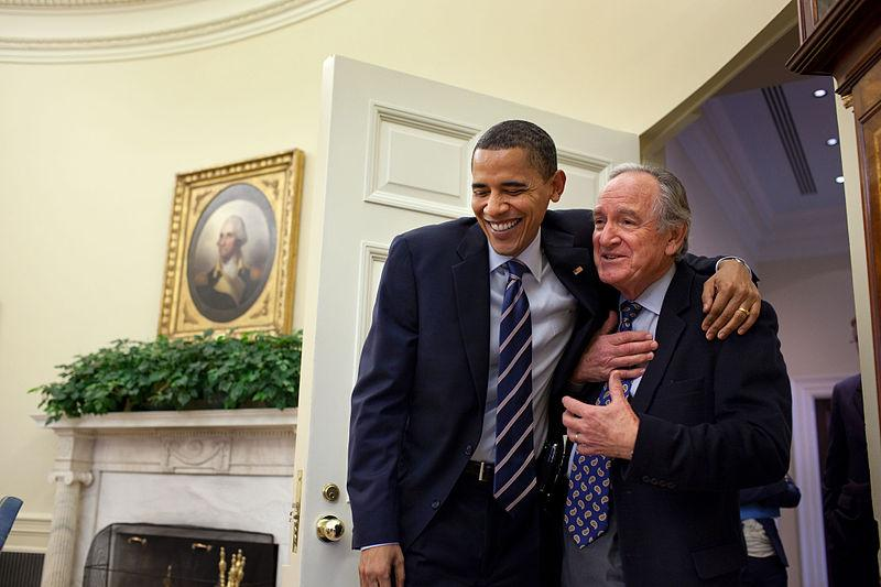 Senator Tom Harkin poses with President Barack Obama after the Affordable Care Act passed Congress.
