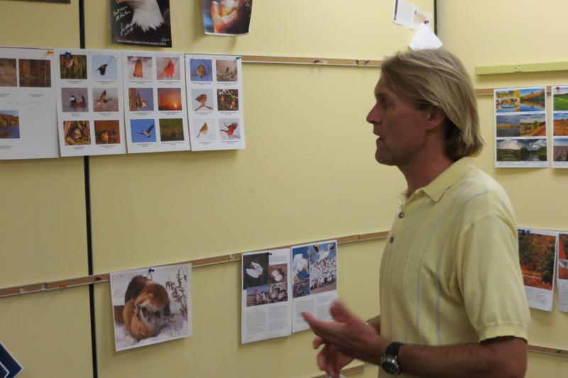 "Brian Button in the ""pin up"" room where the magazine is formatted for printing"