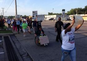Protestors march on W. Florissant Ave. on the evening of August 20, 2014.