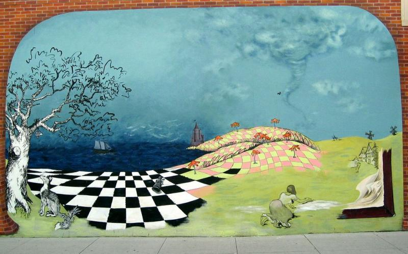 A literature-inspired mural in downtown Iowa City. Can you identify the various books the mural suggests?