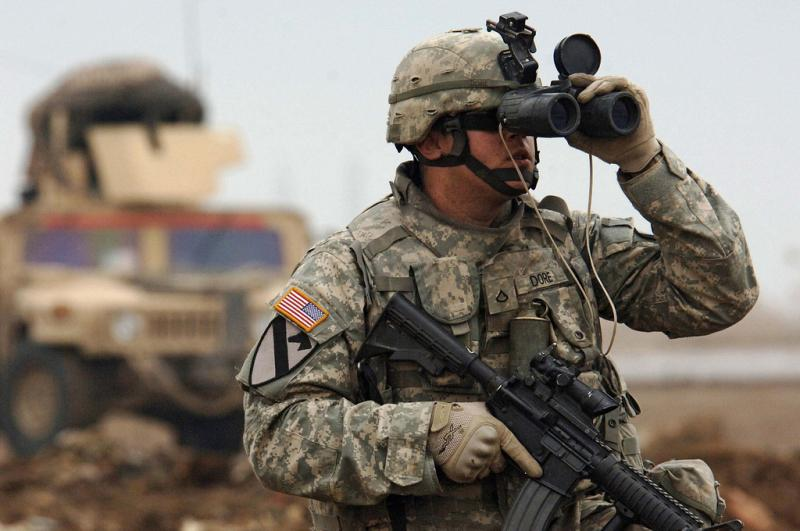 U.S. Army Pfc. Jason Dore looks for any possible enemy contact in western Baghdad, Iraq. 2007