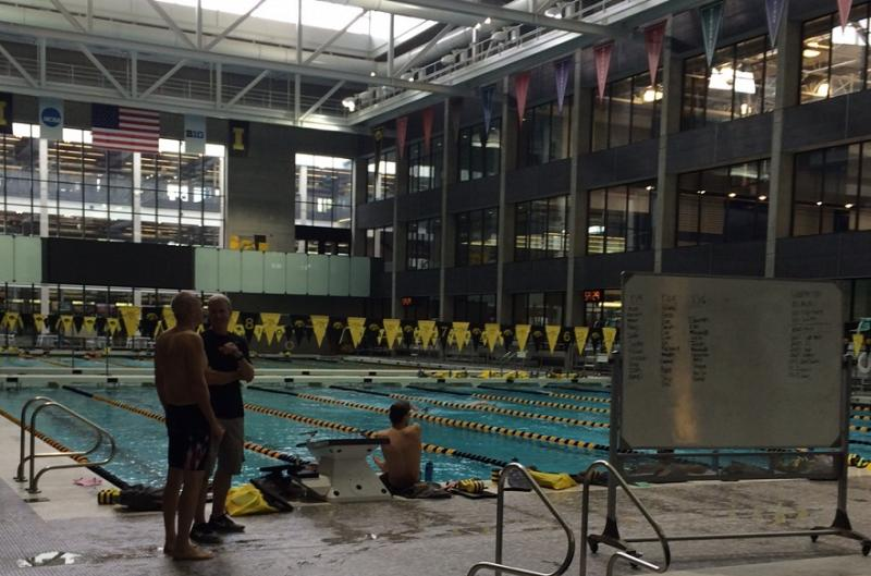 Ben Kieffer stands with UI Swimming Coach Marc Long at the Campus Recreation and Wellness Center at the University of Iowa.