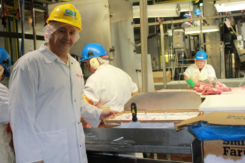 Todd Scherbing, Smithfield Foods' senior director of rendering, holds a tray of pituitary glands that are cut from hogs on the line in the Farmland Foods plant in Milan, Mo. Pituitary glands are used to make insulin.