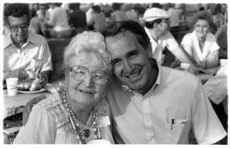 Tom Harkin poses with an attendee of his annual steak fry in 1990