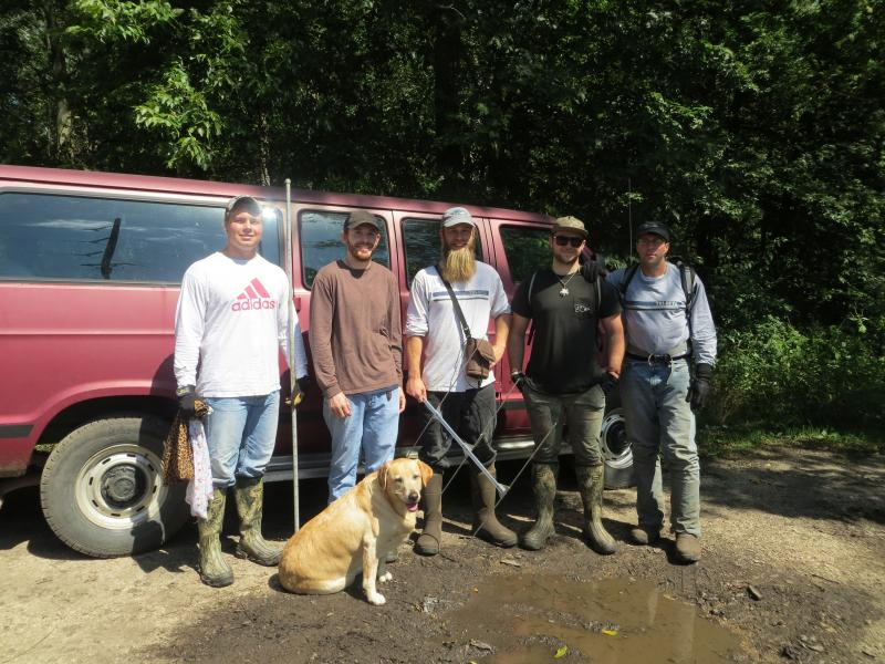 Turtle trackers (left to right) Nick Schemmel, Sam Berg, Buzzard, the turtle sniffing dog, Jeremy George, Anthony DiFronzo and Professor Jeff Tamplin  (team member Joshua Otten not pictured)