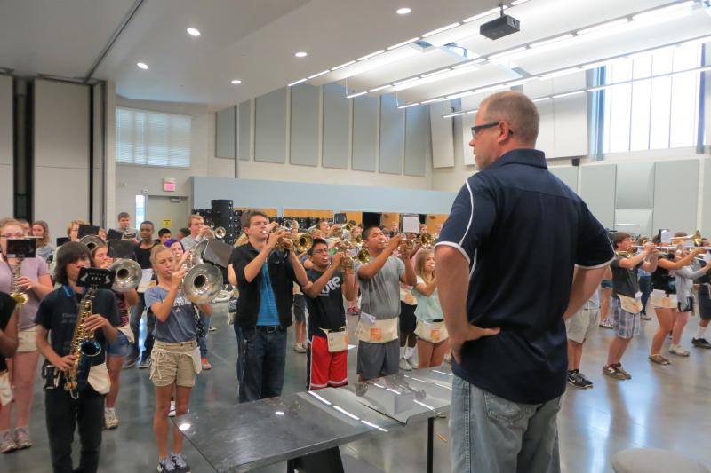 The band director runs a tight ship in preparation for the Sept. 12th performance