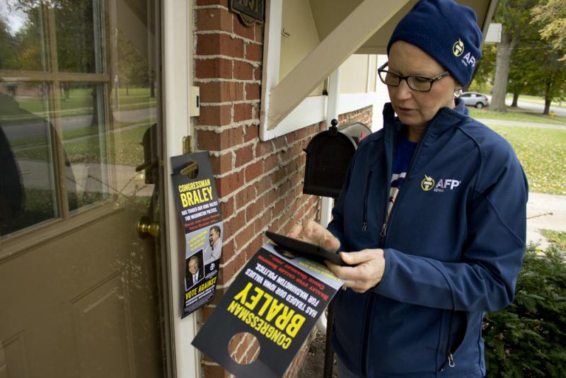 Denise Bubeck knocks doors for Americans For Prosperity's Iowa Chapter in a Des Moines neighborhood.