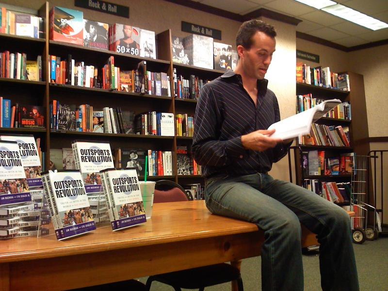 "Cyd Zeigler sits at Philadelphia book signing for his book ""The Outsports Revolution: Truth and Myth in the World of Gay Sports."""