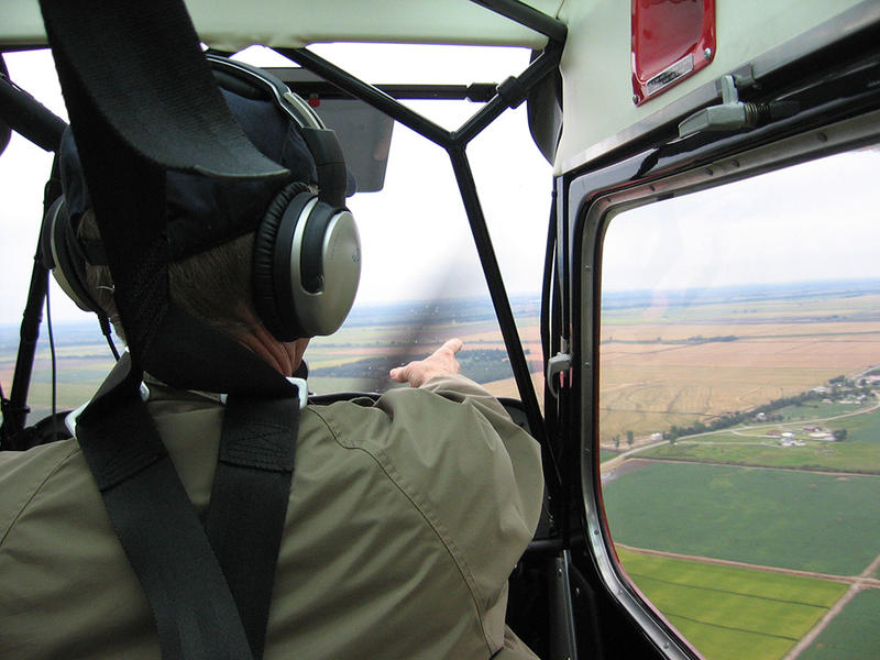 Pilot Mike Lee scouts terrain his pilots will treat over the Missouri-Arkansas state line.