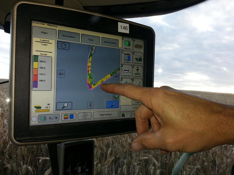 Jim Sladek shows the high tech equipment used to track yields