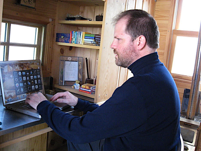 Greg at his desk in his first tiny house.