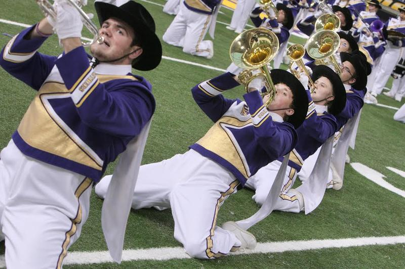 Members of the University of Northern Iowa Panther Marching Band perform one of their half-time shows.