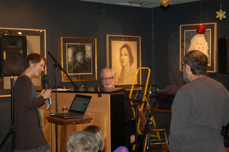 A member of the live audience at Iowa City's downtown Java House tells Dan and Charity a story