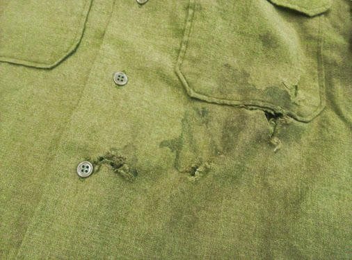 Bullet holes and blood stains on the shirt Phillips wore during the Battle of the Bulge