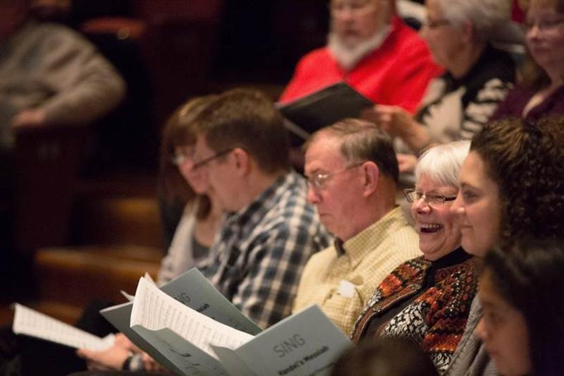 Audience members sing along with the Metropolitan Chorale and wcfsymphony.