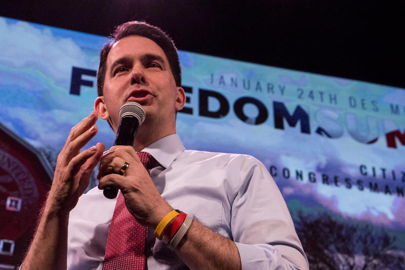 Wisconsin Governor Scott Walker speaks at the 2015 Freedom Summit in Des Moines says the people of Wisconsin like the direction his policies are headed after a contentious recall election, where he retained the role of governor, and won the next election.