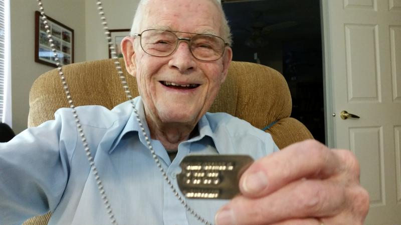 Veteran George Dane with his dog tags.