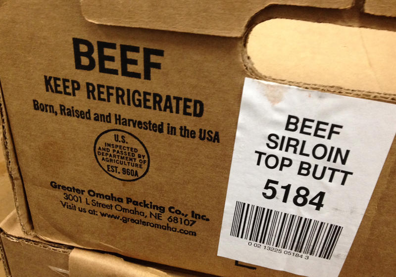 Most beef comes boxed in large cuts that are broken down at the supermarket. The information on the box tells retailers what to say on the country of origin label shoppers find on the shelf.